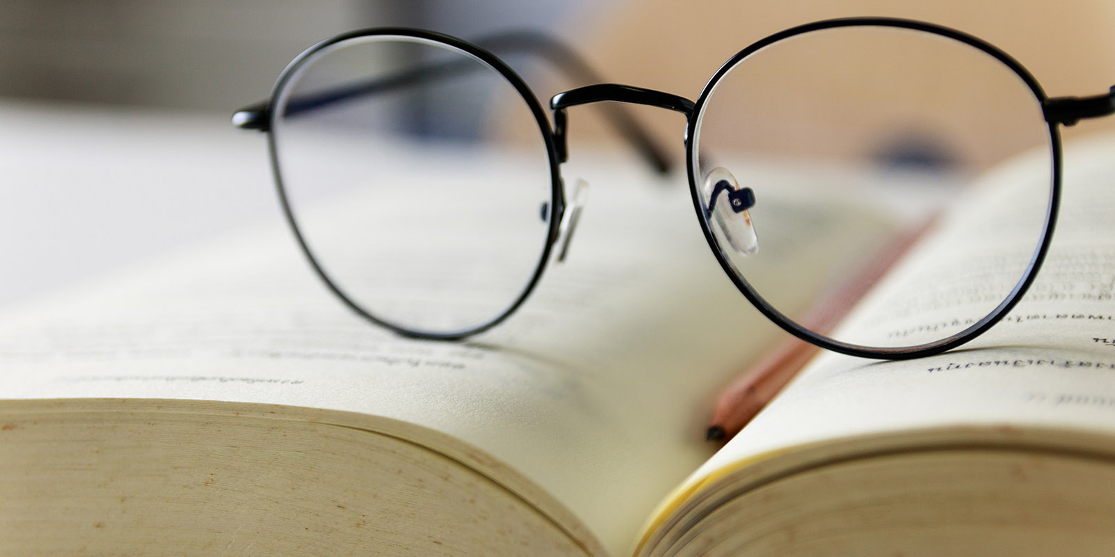 Reading glasses placed on open books